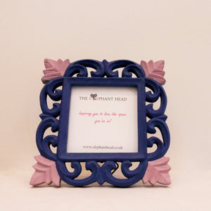 Indigo surround and pale pink flowers front view of picture frame