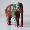 Red elephant with multicoloured floral motifs- side view