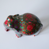 Red elephant with multicoloured floral motifs- top view