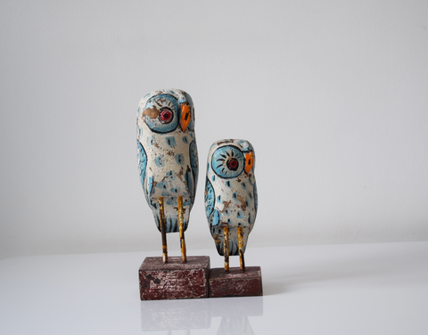 Set of 2 light blue distressed wooden owls - front view