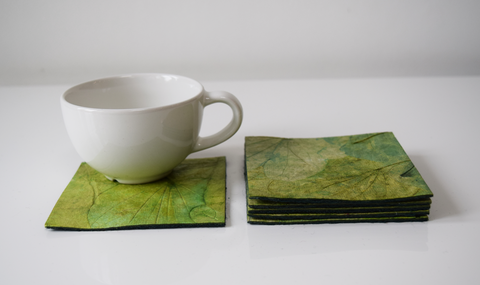 Green handmade paper coasters with cup