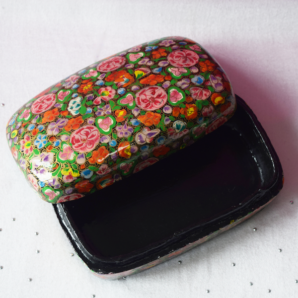 Multicoloured floral paper mache box open with black interior