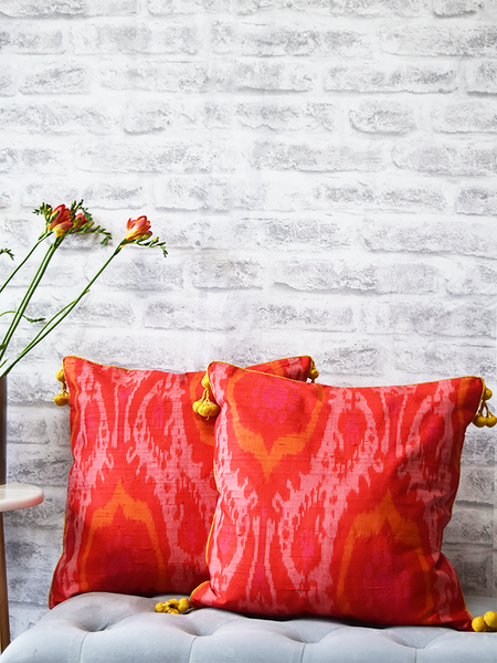Gulmohar, Orange Raw Silk Ikat Cushion Covers with yellow tassels