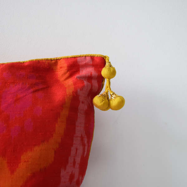 Gulmohar, Orange Raw Silk Ikat Cushion Covers, yellow tassel details