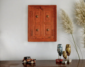 Vintage Indian orange window in a contemporary setting