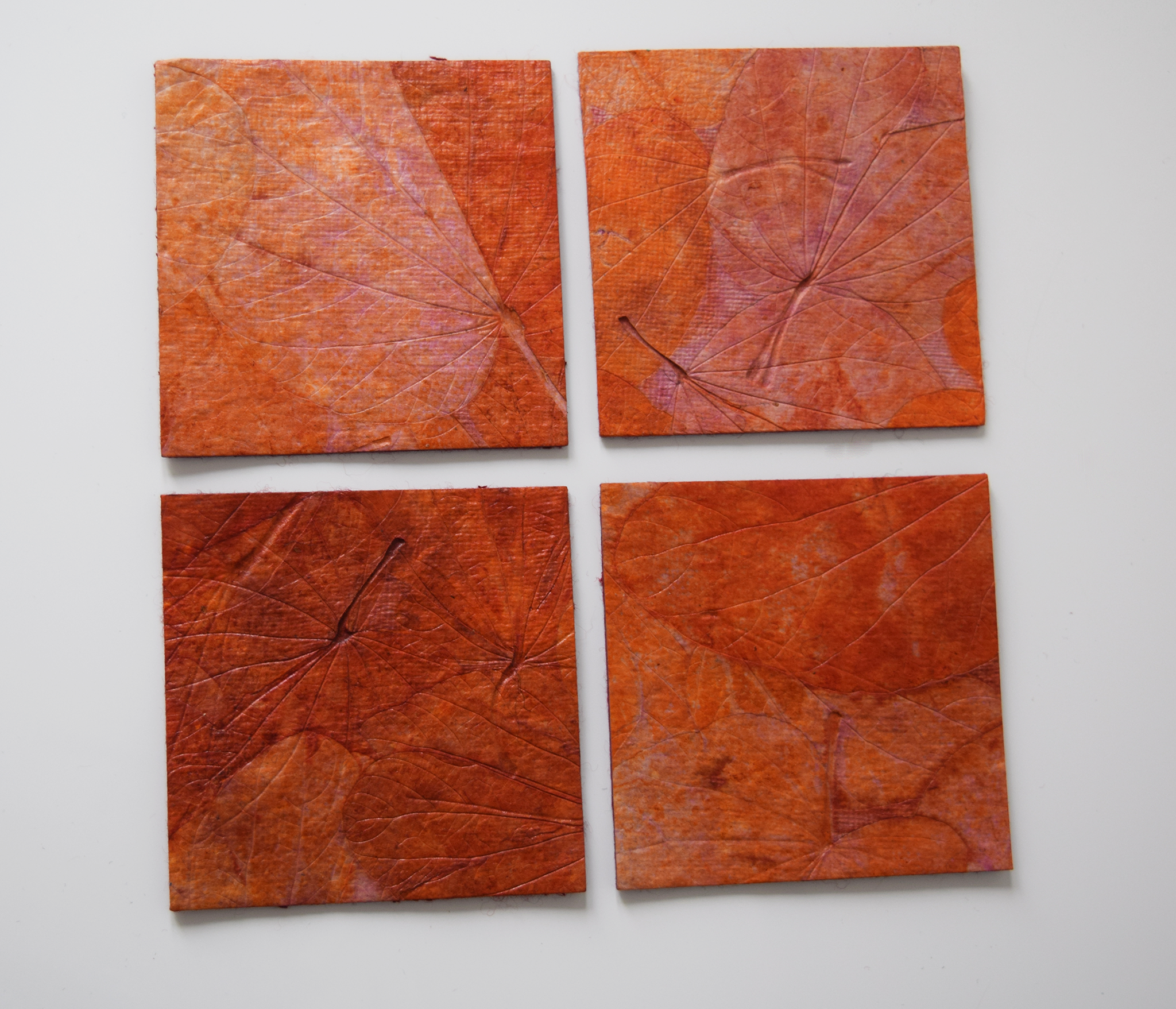Orange handmade paper coasters x4