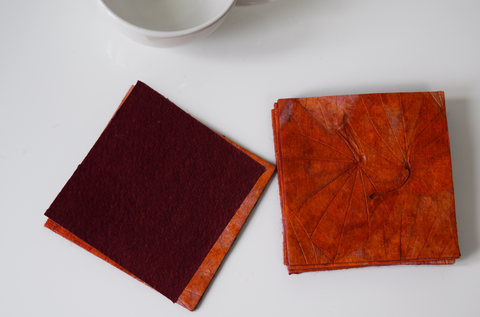Orange handmade paper coasters with backing