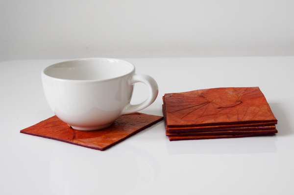 Orange handmade paper coasters with cup