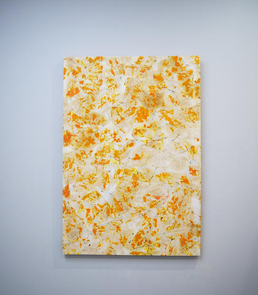 White poster with orange and yellow leaf imprints