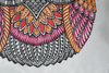 Details of the pink and orange hand embroidery