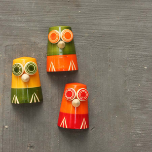 red, yellow and green colourful wooden fridge magnets