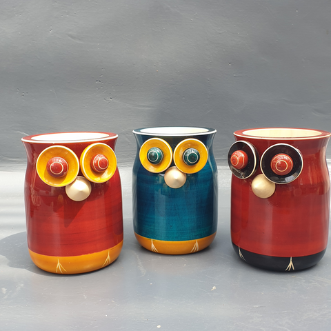 red-yellow, blue-yellow and red-black wooden owl pen stands