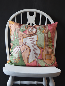 3 hand embroidered female musicians in pastel shades of pink, green, brown, white and gold
