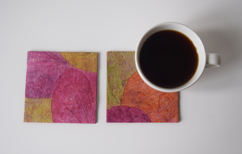 pink, green and purple coasters with cup