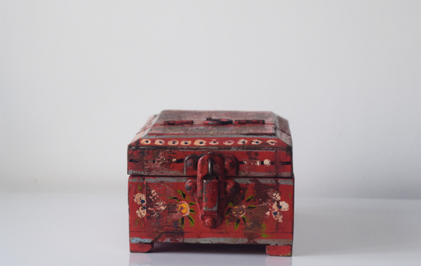 red barber box with floral motif- front view