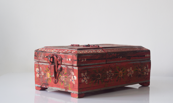 red barber box with floral motif- closed angle view