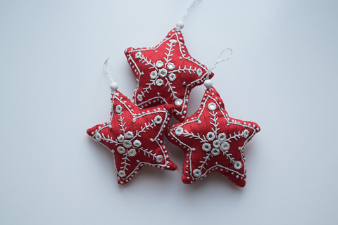 3 Red star shaped Christmas decorations with white embroidery and mirror work