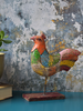 Reclaimed wood rooster, painted in shades of orange, red, green, blue and yellow - alternate view