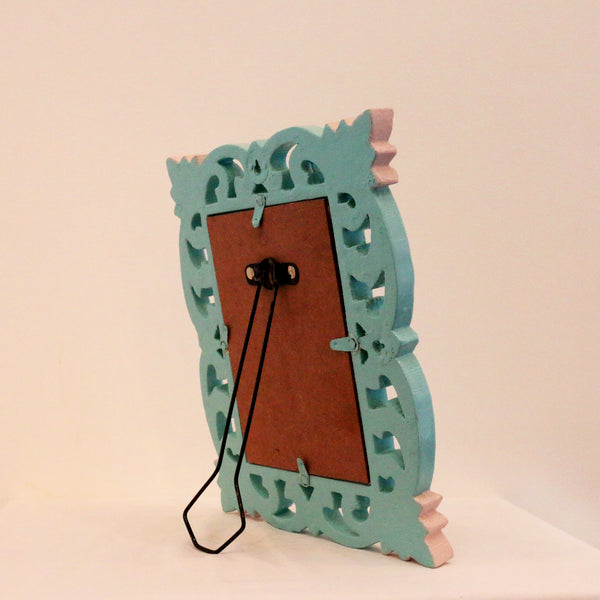 Teal surround and light pink back view with stand of picture frame