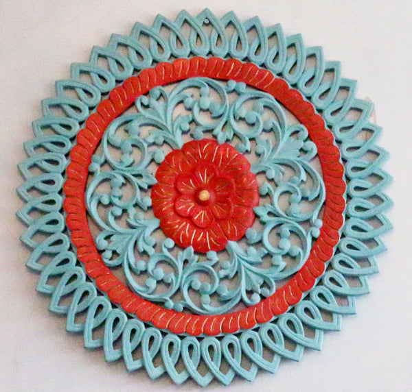 a picture showing the details of the teal and red carved picture