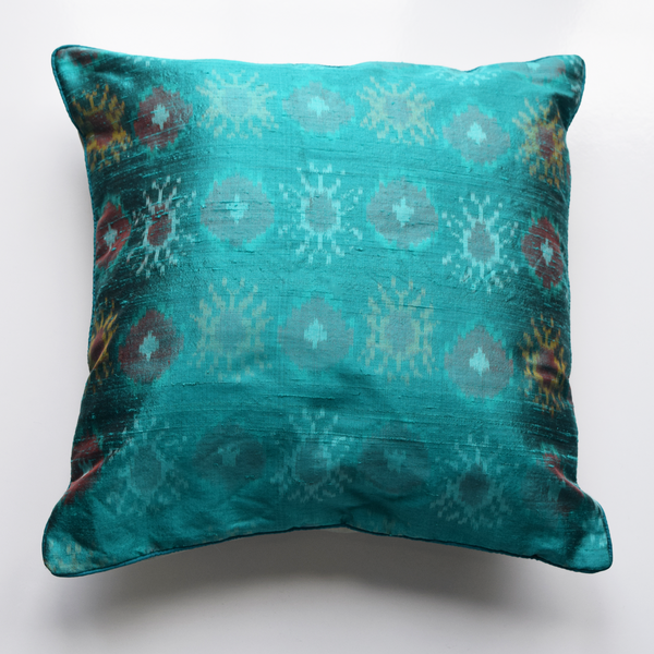 Firozi Turquoise Blue Silk Ikat Cushion Cover on plain white background