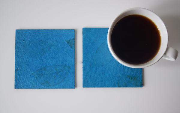 turquoise coasters with benjamin leaf imprint- with cup