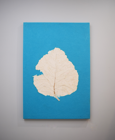 Turquoise handmade paper wall poster with teak leaf imprint