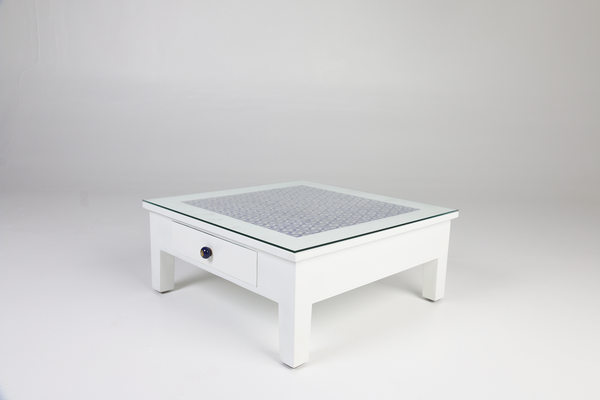 White coffee table with blue pottery tiles and glass top