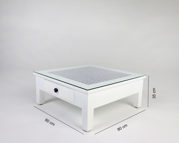 White coffee table with blue pottery tiles and glass top with dimensions
