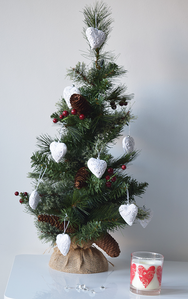 White heart shaped Christmas decorations with white embroidery and mirror work on tree