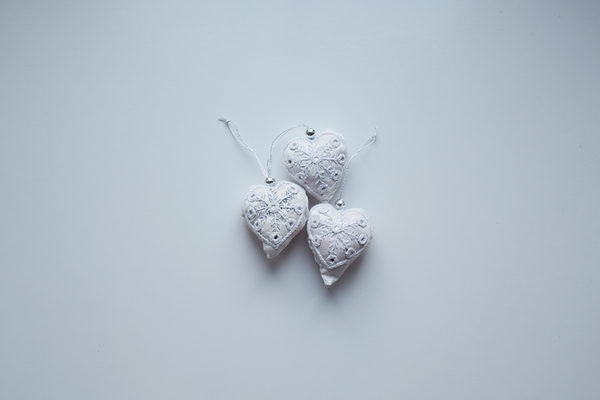 3 White heart shaped Christmas decorations with white embroidery and mirror work