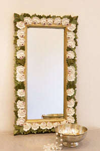 front image of gold frame with all around white roses and green leaves