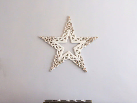 White star on grey background with a charcoal and white candle stand