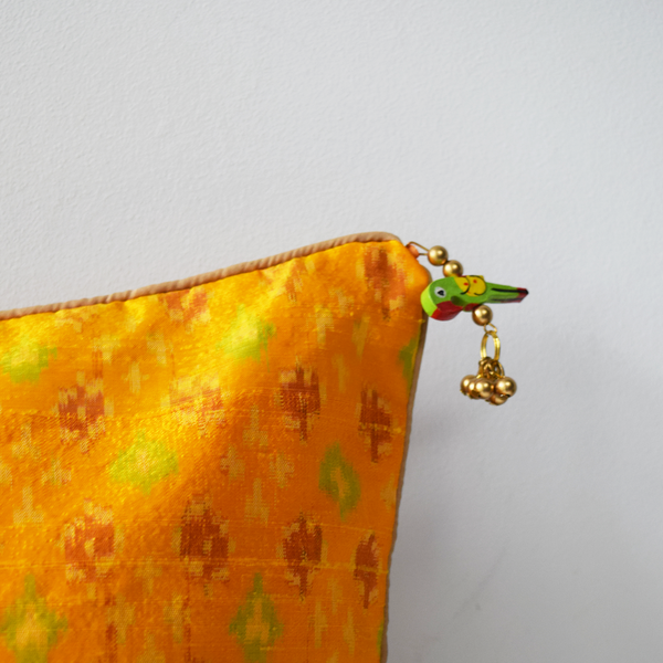 Yellow Silk Ikat Cushion Cover with Green Wooden Bird Tassel