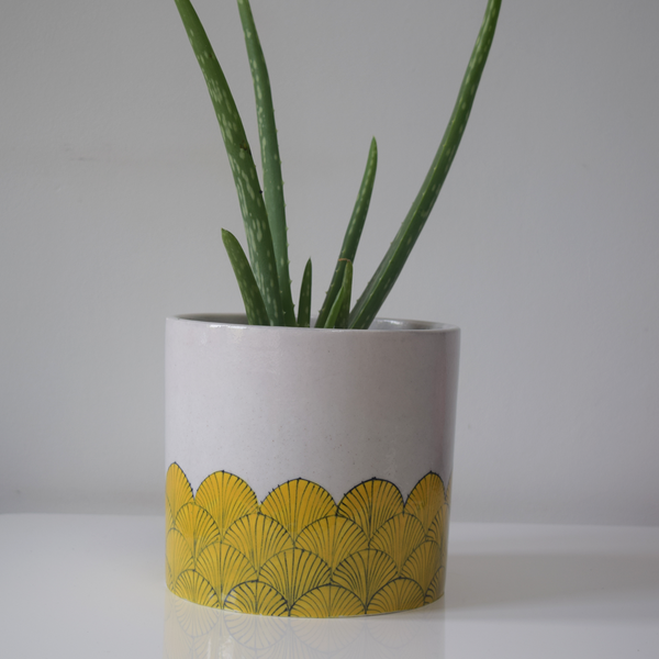 pankha, yellow and white fan patterned planter
