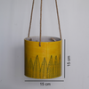 Pattee, yellow hanging planter with black leaf pattern -with measurements