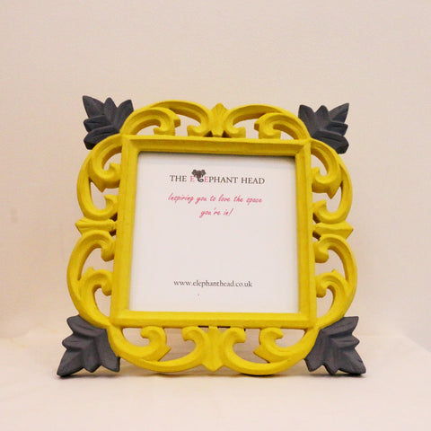 Yellow surround and old violet flowers front view of picture frame