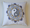 Embroidered yin-yang cushion cover in shades of ochre and lilac