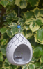 pictured in garden- black and white floral patterned tealight holder with blue bead on string