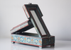 Light blue barber box with floral motifs -alternate side angled view