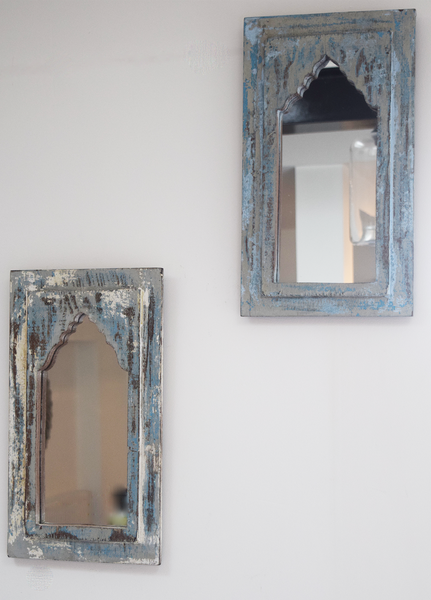 Rustic blue, cream and grey distressed mirrors on wall