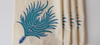 details of the peacock feather pattern on napkins