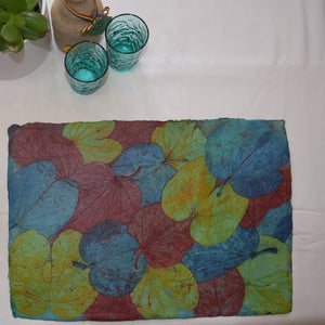 blue, green and red hand made paper tablemat