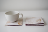 cream Benjamin imprint coasters with cup
