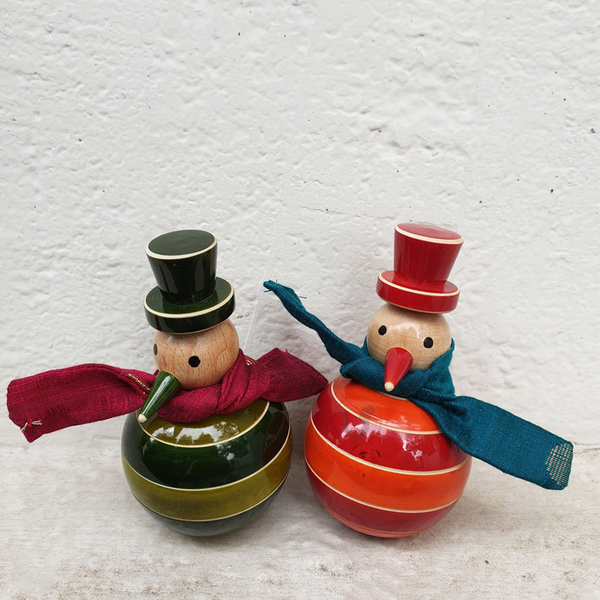 green and orange wooden dancing snowmen