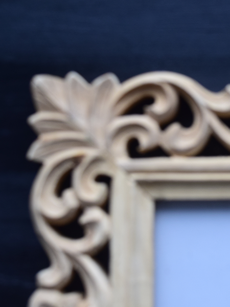 carved details of wooden frame