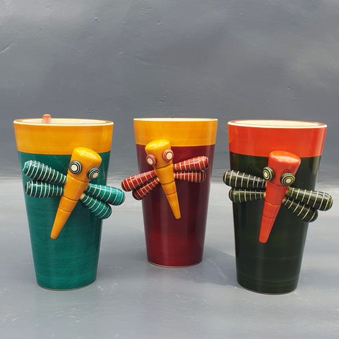 red-yellow, green-yellow and orange-green dragon-fly pen stands