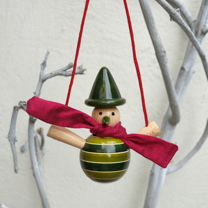 green snowman on a swing ornament