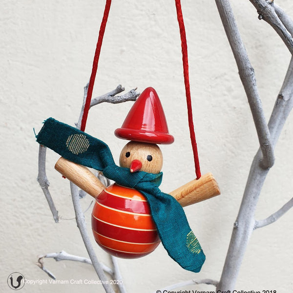 orange snowman on a swing ornament