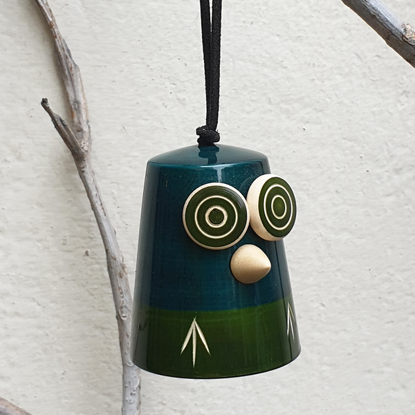 blue-green wooden owl bell